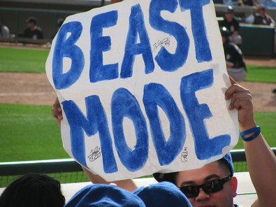 Spring Training 2010 Sleeping beauty with a sign.jpg