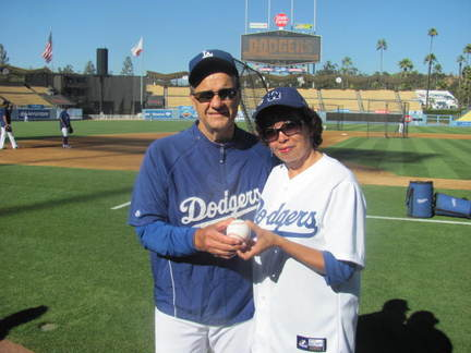 Joe Torre handing me the Sandy Koufax baseball (2).jpg