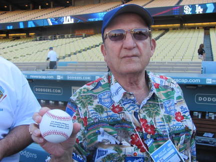 Jorge Bahaia with the ceremonial first pitch baseball.jpg