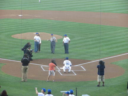 Jorge Bahaia throwing out the first pitch.jpg