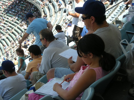 Father and daughter keeping score at Dodger Stadium .jpg